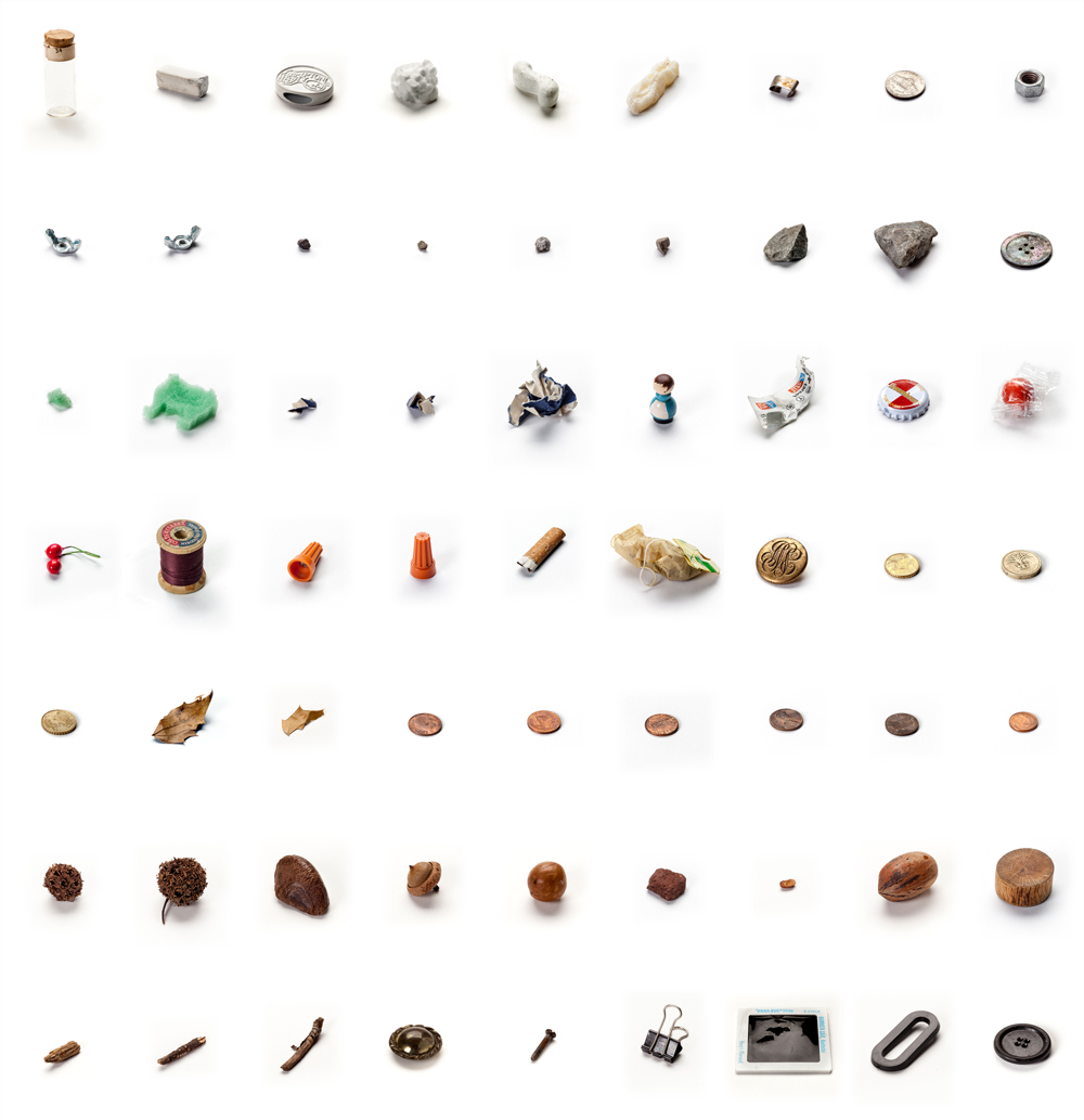 "Lenka Clayton, ""63 Objects Taken from my Son's Mouth"", (2011–2012), materials as described by Clayton: ""acorn, bolt, bubblegum, buttons, carbon paper, chalk, Christmas decoration, cigarette butt, coins (GBP, USD, EURO), cotton reel, holly leaf, little wooden man, sharp metal pieces, metro ticket, nuts, plastic ""O"", polystyrene, rat poison (missing), seeds, slide, small rocks, specimen vial, sponge animal, sticks, teabag, wire caps, wooden block"". Image courtesy lenkaclayton.com."