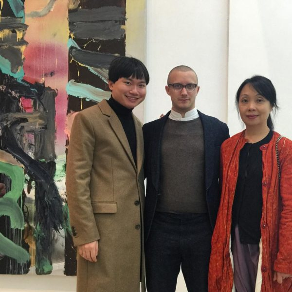 "Robin Peckham (center) at the opening of the exhibition ""Full of Peril and Wierdness: Painting as a Universalism"", 29 October 2015 – 25 January 2016, at M Woods, Beijing. Image courtesy of Han Zong."