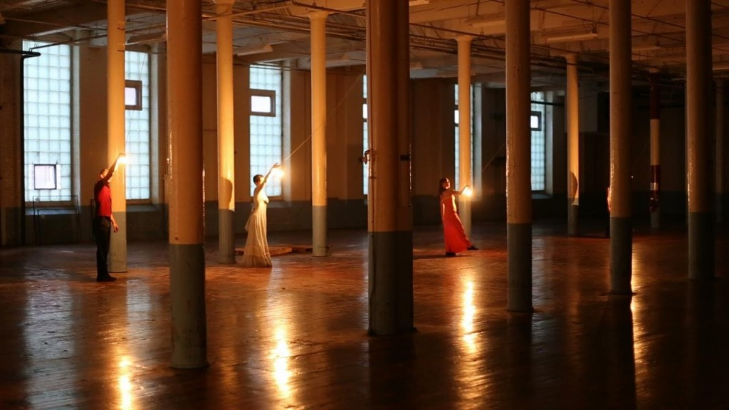 Still from Thine Eyes (2013) by Subcircle. Scott McPheeters, Christina Zani, Christy Lee. Taken in performance at Pepperell Mills, North Dam Campus, Biddeford. Photo by Jorge Cousineau.