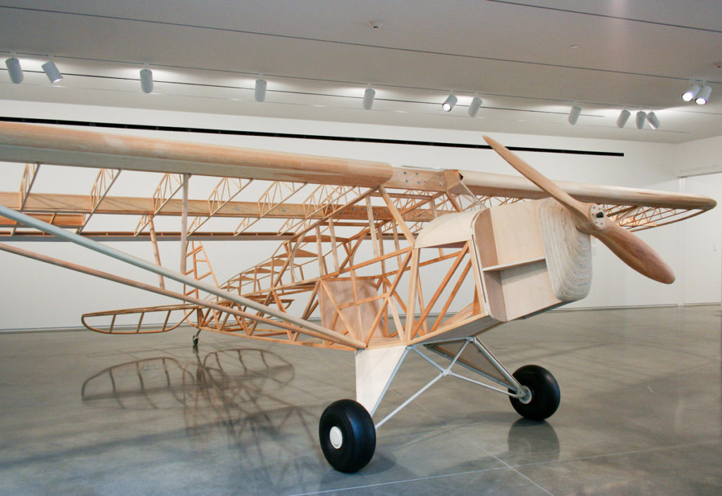 Mark Wethli, Piper Cub, pine, birch plywood and aircraft parts, 35 x 22 x 7 ft., 2007.